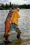 Fisherman Holding 76lb King Salmon Moose River KP Alaska