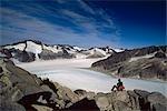 Hiker sitting rocks Juneau Ice Field Mendenhall Southeast Alaska Glacier summer scenic