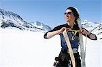 Woman Climber Attaches Climbing Skins to Skis AK SC Spring Chugach Mtns