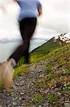 Woman runs up Mt Marathon during race Seward Alaska Kenai Peninsula Summer