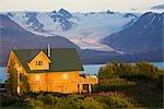 Sunset on a Log home that overlooks Kachemak Bay above Homer on the Kenai Peninsula in Southcentral, Alaska