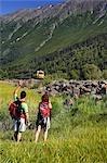 Family views AK Railroad Passenger Train near Bird Point, Turnagain Arm, SC Alaska Summer. Chugach SP