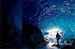 Hiker Mendenhall Glacier Exploring Ice Cave AK Southeast