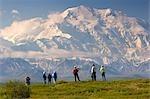 Group of tourists view Mt.McKinley from tundra overlook near Wonder Lake Denali National Park Alaska
