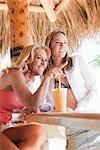 Woman Sitting at Bar in Tiki Hut, Florida, USA