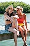 Two Women Sitting on Dock, Florida, USA