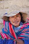Woman wearing traditional blanket,Cordillera Real,Bolivia