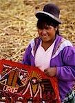 Woman with traditional cloth,Uros Islands,Lake Titicaca,Peru