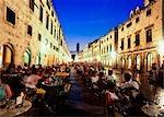 People in cafes at dusk on Stradun,Dubrovnik,Croatia