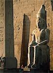 Tourist reading guidebook at obelisk,Luxor Temple,Luxor,Egypt