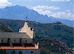 Church and mountains,Haute-Balagne view towards Pigna Porto,Corsica