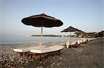 Row of sun umbrellas and loungers,Ixia,Rhodes,Greece