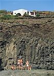 Children on rocks,Pantelleria,Sicily,Italy.