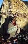 Handicraft seller,Uros Islands,Lake Titicaca,Peru