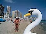 Man beside swan shaped boat,Benidorm beach,Spain
