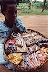 Girl holding basket of spices,Zanzibar Island,Tanzania