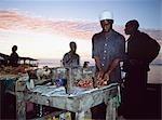 Man cooking kebabs in sunset,Stone Town,Zanzibar,Tanzania