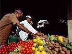 Fruitsellers laying out fruit,Stone Town,Zanzibar Island. Tanzania