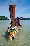 Long-boat and boatman,Ko Phi Don island,Thailand