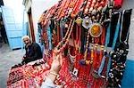Female tourist at jewellery stall,Central Medina / Souq,Tunis,Tunisia,North Africa