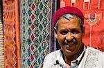 Souvenir shop keeper by carpets,Medina,Tozeur,Tunisia,North Africa
