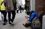 Homeless man prays for help,New York City,New York,USA