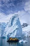 Tourists in Zodiac Boat by Iceberg, Antarctica