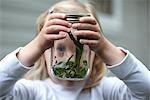 Girl Looking at a Caterpillar in a Jar