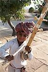 Portrait of Boy using Traditional, Musical Instrument, Jaswant Thada, Jodhpur, Rajasthan, India