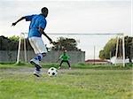 Teenage boys playing football