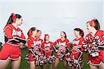 Cheerleaders laughing