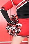 Cheerleader with pom pom
