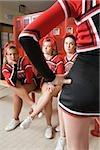 Cheerleaders in locker room