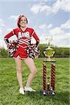 Cheerleader with trophy