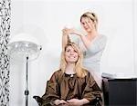 Woman having haircut