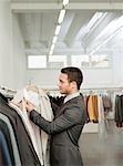man shopping looking at jackets