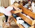 Girl looking through drawers