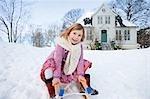 Scandinavian girl on a sled