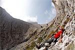 Man Lying on Rocks, Brigata Tridentina Via Ferrata, Sella Massif, Dolomites, Italy