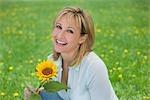 Woman Holding Sunflower