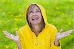 Woman Wearing Raincoat Standing in the Rain