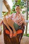 Femme se détendre dans une chaise, Punta Burros, Nayarit, Mexique