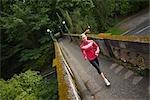 Woman Running on Bridge in Arboretum, Seattle, Washington, USA