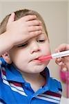 Boy being given medicine