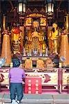 Worshipper praying in Temple of city god,Yu Yuan,Shanghai,China