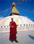 Buddhist Monk in front of Bodnath Stupa, Bodnath, Kathmandu, Nepal, Asia