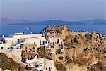People gathering to watch the sunset, Oia village, Oia, Santorini (Thira), Cyclades islands, Greece, Mediterranean, Europe