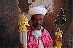 Portrait of a man holding Christian symbols,Gabriel and Raphael,Bieta Mercurios,Lalibela,Wollo region,Ethiopia,Africa