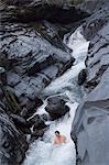 Man enjoying natural hot river water of Tona hotspring bath resort,Maolin,Kaoshiung County,Taiwan,Asia