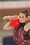 Girl performing rhythmic gymnastics with ball